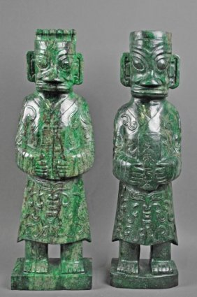 LARGE PAIR SANXINGDUI-STYLE CARVED STONE FIGURES