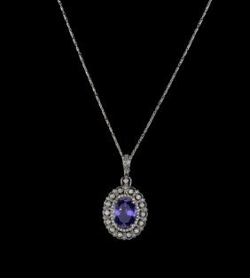 14 Kt., Tanzanite And Diamond Pendant With Chain