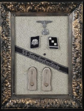 FRAMED COLLECTION OF NAZI SS INSIGNIA VISOR DEVICES