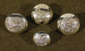 FOUR BRITISH MILITARY COAT BUTTONS