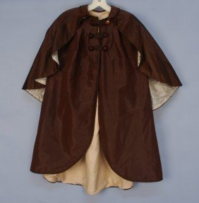 INFANT'S SILK CLOAK With ATTACHED CAPE, 1868. Brow