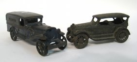 Two Cast Iron Cars