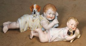 TWO GERMAN BISQUE PIANO BABIES WITH PUPPY. (1)10