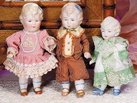"THREE GERMAN ALL-BISQUE DOLLS.  4 �"" To 5 �"".  Each"