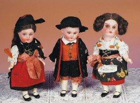 THREE TINY ALL-ORIGINAL GERMAN BISQUE DOLLS.  Eac