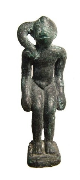 An Egyptian Bronze Figure Of Seated Harpokrates