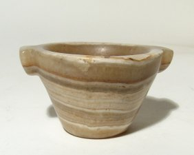 An Egyptian Middle Kingdom Alabaster Mortar-shaped