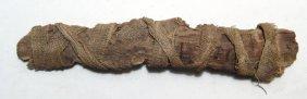 An Egyptian Votive Scroll Wrapped In Linen, Roman