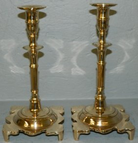 Pair Of Polished Brass Footed Candlesticks.