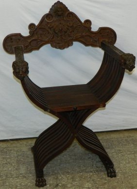 Scissor Chair With Carved Lion Head Arms.