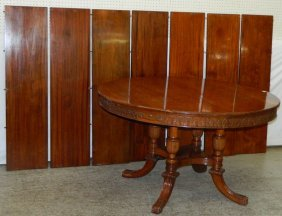 Round Mahogany Regency Table With 7 Leaves.