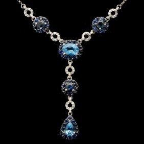 BLUE TOPAZ, SAPPHIRE, DIAMOND, 14K W/G NECKLACE.