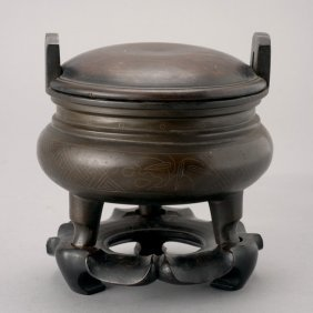 A Silver Inlaid Bronze Tripod Censer, 18th C