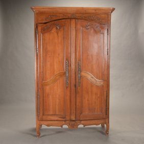 French Provincial Walnut Armoire Carved With Leafy Vine