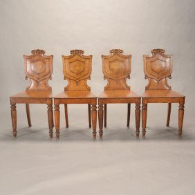Four English Regency Oak Shield Back Hall Chairs