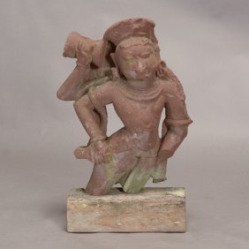 An Indian Red Sandstone Fragment Of A Four-armed Deity,