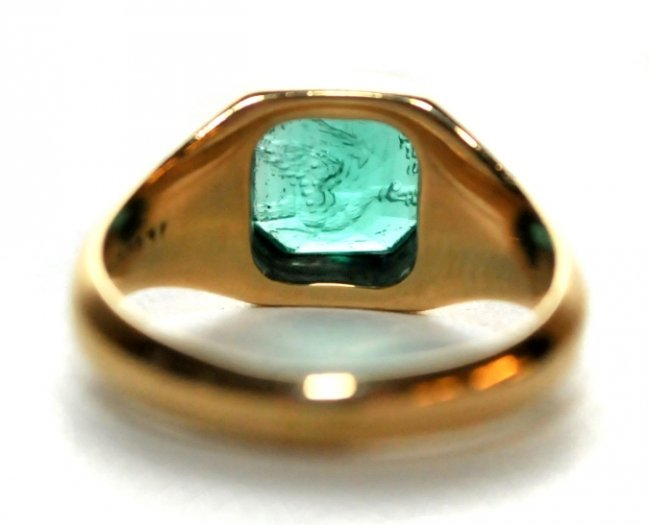 137 an 18kt yellow gold and engraved emerald signet r