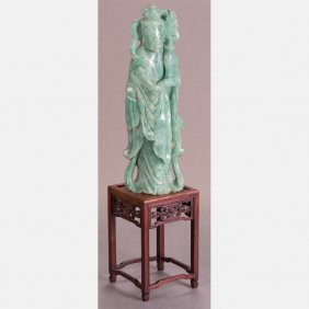 A Chinese Carved Green Nephrite Jade Figure Of Guanyin