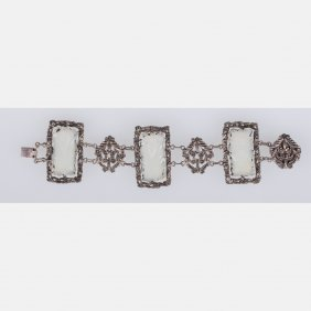A Chinese Silver And White Jade Bracelet.