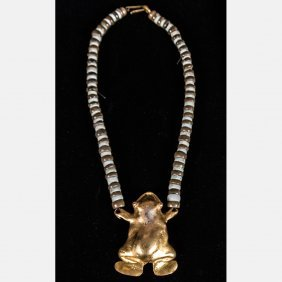 A Pre-columbian Gold Frog Pendant With Pale Green