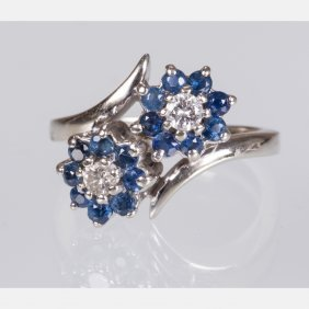 A 14kt. White Gold, Diamond And Sapphire Ring,
