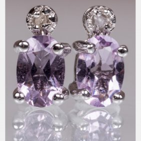 A Pair Of Silver, Amethyst And Diamond Earrings