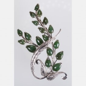 A 14kt. White Gold And Emerald Brooch.