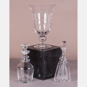 A Collection Of Blown Glass Decanters And Footed Vase,