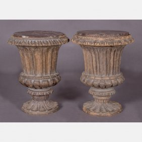 A Pair Of Carved Hardwood Urn Form Side Tables With