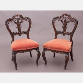 A Pair Of Victorian Elaborately Carved Rosewood Side