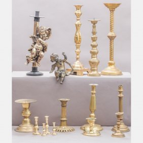 A Miscellaneous Collection Of Brass Candlesticks,