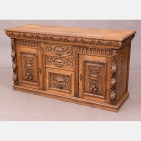 A Continental Heavily Carved Oak Cabinet, 20th Century.