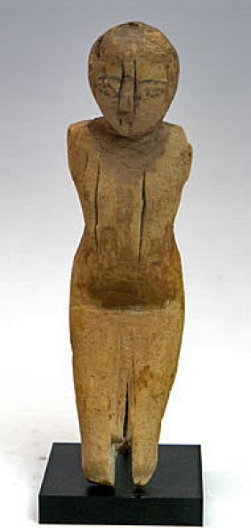 An Egyptian Wooden Boatman, Middle Kingdom