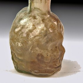 A Roman Green Glass Janus Head Flask