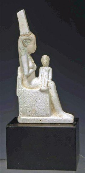 An Egyptian Pale Faience Isis Nursing Infant Horus