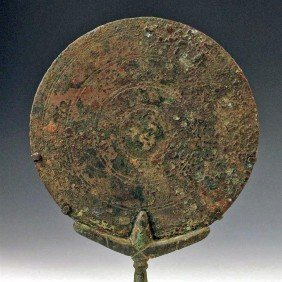 A Roman Bronze Hand-Held Mirror