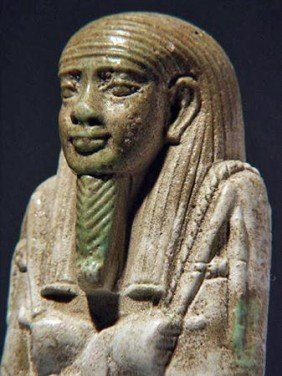 An Egyptian Composite Faience Ushabti - Psamtek