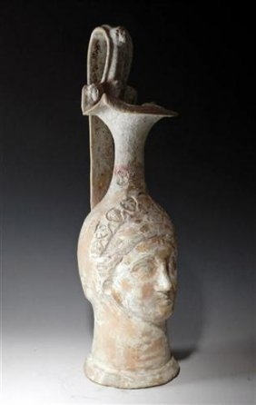 An Unusual Canosan Pottery Figural Vase