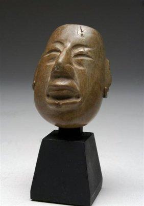 An Olmec Stone WereJaguar Mask, Ex-Museum