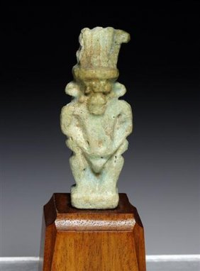 An Egyptian Faience Amulet Of Bes