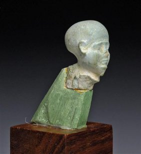 An Egyptian Faience Head Of Priest