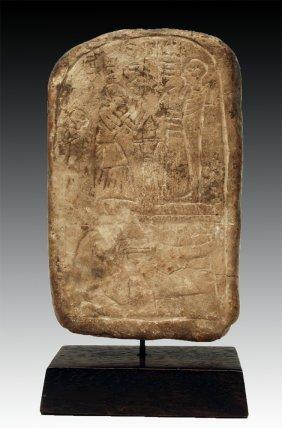 An Egyptian Limestone Round Top Stele