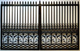 LARGE PAIR OF DECORATIVE HEAVY CAST IRON GATES