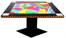 A SQUARE COLLAGE GAME TABLE WITH BRIGHT COLORS