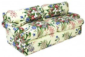 A FLORAL UPHOLSTERED TWO CUSHION SOFA