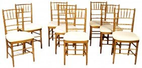A SET OF EIGHT GOLD FAUX BAMBOO SIDE CHAIRS WITH LO