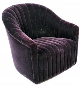 AN ART DECO STYLE CHANNEL UPHOLSTERED CLUB CHAIR WI