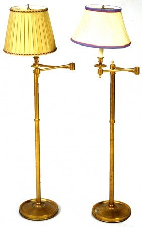 A PAIR OF BRUSHED BRASS SWING ARM FLOOR LAMPS