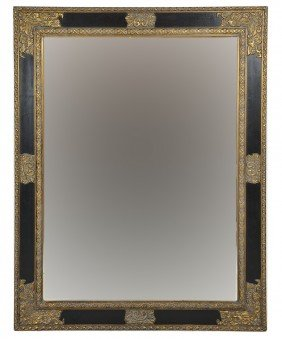 A LARGE LACQUER AND PARCEL FRAME BEVELED MIRROR