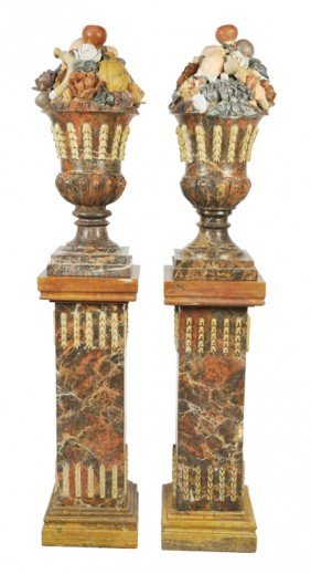A PAIR OF MARBLE FRUIT URNS ON PEDESTALS Italy, 20t